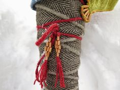 handwoven leg wraps (with tubular selvages) and decorated ties in use.