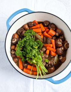 Guiness Beef Stew ~ 3 T. butter, divided ~ 8 thick cut bacon slices, chopped ~ 5 large shallots, cut in fourths ~ 2 lbs. stew beef, cubed ~ 12 oz. crimini mushrooms, whole ~ 5 carrots, chopped into large hunks ~ 2 15 oz. cans Guinness ~ 1 bunch parsley ~ 2 bay leaves ~ Kosher Salt ~ Fresh Black Pepper
