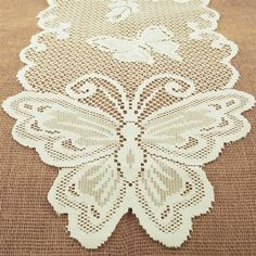 Give a dining table, buffet, or dresser an heirloom look of simple elegance. This finely crafted table runner features a butterfly trim. But unlike true antique lace, this is made of durable polyester