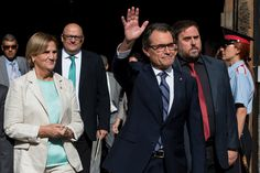 President of Catalonia Artur Mas (C) waves as he leaves the Palau de la Generalitat, the Catalan government building, next to President of the Parliament of Catalonia Nuria de Gispert (L) and Leader of the Pro-Independence political party Esquerra Republicana de Catalunya (ERC) Oriol Junqueras on September 27, 2014 in Barcelona, Catalonia. President of Catalonia Artur Mas has signed the decree to call for a self-determination referendum from Spain on November 9.