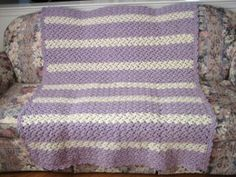 Enjoy a lazy day with this Lazy Lavender Shell Throw. Made with soft purple and white yarn, this beautiful afghan is great for girls of all ages. Use it to add color to a bedroom or living room.