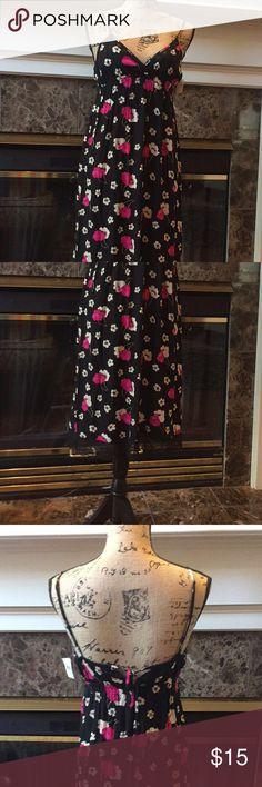 NWT Floral, Fun, & Flirty Dress! This cute, fun & flirty floral dress is just right for the hot summer days it's very comfortable made of 100% rayon it adorned with lace at the bottom of the dress and trimmed along the breast of the dress as well it has elastic around the upper bodice of the dress for comfort and a string in the back with a little peek-a-boo in the back that adds a little of sex appeal to the innocence of the dress Dresses Midi