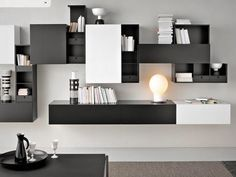 Image from http://www.pocketpclinks.com/wp-content/uploads/2015/05/modern-masculine-home-interior-design-ideas-in-black-and-white-color-scheme-feats-compact-bookshelves-buffets-wall-unit-in-bright-lighting-concept.jpg.