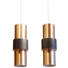 "TITLE:	 Jo Hammerborg ""Etna"" Pendant Lights PRICE:	 On Hold CREATOR:	Fog & Mørup (Manufacturer), jo hammerborg (Designer) COUNTRY:	 Denmark CREATION DATE:	 1960s"