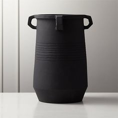Hand-thrown terracotta vase makes a modern statement in matte black glaze. Geometric handles round the rim and concentric center rings add fine detailing. Not watertight, so best for faux blooms or left solo. Tall White Vase, Black And White Vase, White Vases, Blue Glass Vase, Red Vases, Constantino, Round Vase, Taper Candle Holders, Metal Vase