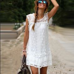 White Lace DressHost Pick Gorgeous White mini Lace sun dress with an underlay!! The perfect white dress for vacation or for the Holidays coming up!! 30 inches long and more fitted than loose and flowy. I have Boho Style bracelets that look Amazing with this dress! Discounts on Bundles!! Dresses Mini