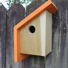 The Nook | A Modern Birdhouse The Nook is a modern / minimalist birdhouse designed and built per the Audubon and Cornell Universitys recommendations for nesting boxes. This birdhouse is suitable for both bluebirds and wrens. The back is removable for the recommended annual cleaning. The modern/minimalist lines and design would make a perfect addition to your modern backyard. You may mount the house on a pole, fence, wall, and or tree utilizing the mounting hole in the back. If you...