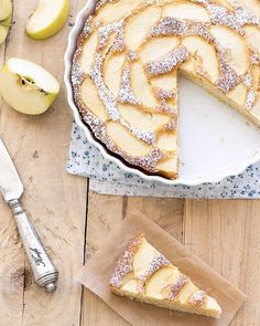 Low fat apple cake - a slice of apple cake on a rustic wooden table.