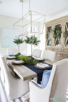 Blue and white dining room with light natural wood tones