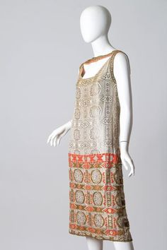 Embroidered 1920's Art Deco Lamé Dress, France. Silver lamé jacquard of this dress has been hand embroidered with metal and silk threads.  https://www.1stdibs.com/fashion/clothing/evening-dresses/embroidered-1920s-lame-dress/id-v_948362/