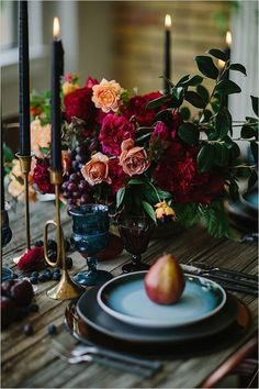 Rich Autumnal Hues: Black Candles, Burgundy Flowers and Teal Plates | Tabletop
