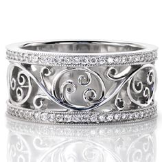 Catalina Petite - Catalina Petite incorporates the unique free flowing filigree from our Catalina design but in a slightly narrower width. The captivating filigree adds a sense of movement to this truly stunning design. The pattern is framed on either side by a row of micro pavé diamonds adding brilliance to the white gold metal.