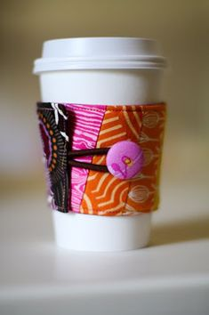 Reusable fabric sleeve coffee cozy. Learn how to make one for yourself or gift with this tutorial #make #sew