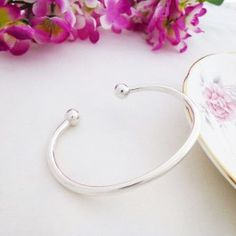 Ladies Solid Silver Torque Bangle