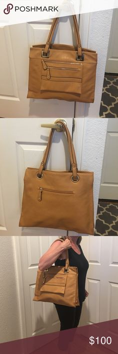 """ROBERT MATTHEW BAG Beautifully saddle color RM bag. Used only once. Good travel tote with 3 large compartments- 2 zip and middle one magnetic snap. W 16""""xH 13x D7"""". Beautiful striped satin lining. No spots, stains, scuffs inside or out. Outside pocket zips off and measures 9"""" x 6. """" as seen in photo 7. shoulder strap has  10"""" drop. Only used once. Includes Dust Bag. ❌FIRM ❌unless bundled for %10 discount. ROBERT MATTHEW Bags Shoulder Bags"""