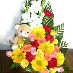 Buy A #cute teddy sitting inbetween flowers from flowersforindia through online. http://flowersforindia.com/index.php?route=product/product&path=63&product_id=92