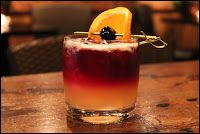 New York Sour  2 oz Rye  1/2 lemon, juiced  1 sugar cube 1 teaspoon Grand Marnier  1/2 oz Cabernet Sauvignon, floated on top   Garnish: orange wheel, cherry   The short story, it is said, is best experienced in one quenching gulp. So the next time you reach for Hemingway, London, O'Connor, or whoever else is on your bookshelf and bucket list, take a moment to mix yourself something to sip on.