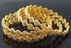 Glow your traditional look for the upcoming party by wearing these bangles.
