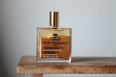 dry oil with a shimmer by nuxe.    http://www.nuxe.com/en/huile-prodigieuse-9/huile-prodigieuse-fr-12