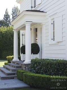 Detail of the side entrance with Doric columns. Photographer: David Duncan Livingston