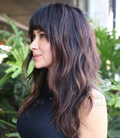 Long Shaggy Cut with Arched Bangs
