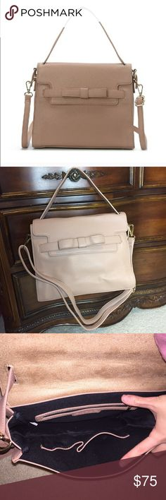 """Ada Ribbon Satchel In Taupe This is a gorgeous and chic purse with a single handle with a detachable shoulder strap. Your items will be secured inside of the bag with a fold over flap. PURSE MEASUREMENTS 30cm {length}x 13cm {width} x 24cm {depth}                                                        Approximately 6"""" handle drop /// Detachable shoulder strap approximately 18-23"""" strap drop /// 2 interior pockets Approximately 10"""" H x 12"""" W x 5"""" D /// Both the top handle and the detachable…"""