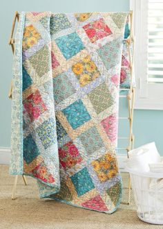 Corner Pocket Quilt - Fabrics are from the Victorian Modern collection by Modern Quilt Studio for Andover Fabrics.