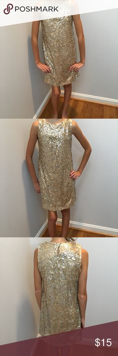 🆕 Zunie girl's gold sequence lined dress size 8 Dress is perfect for the holidays. Your little girl would look stunning in this gold sequenced dress. It is new with tags and it's fully lined. Zunie Dresses Formal
