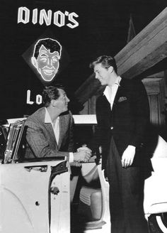 "Dean Martin greeting actor Edd Byrnes upon arriving at Dino's Lodge, Martin's bar and grill at 8532 Sunset Boulevard, the iconic location of the television series 77 SUNSET STRIP in which Byrnes co-starred as ""Kookie"" (ca. 1959)."