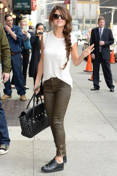 Selena Gomez arriving @ David Letterman show in olive skinnies, a white tee, her Versace bag, and Louis Vuittton sneakers. #outfitinspo