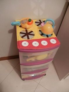 How cute is this rubbermaid bin disguised as a kid's stove?