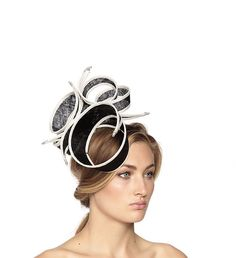 If you fancy alternative head wear, opt for the 'The rings' by Vivien Sheriff. The crazy curls will me an instant head turner! Hire it here at @blind summer Want Wear: http://www.wishwantwear.com/accessory-hire/hats/vivien-sheriff/678-the-rings.html