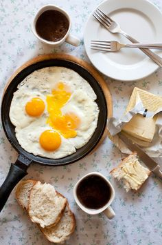 Breakfast. Eggs and bread with butter.