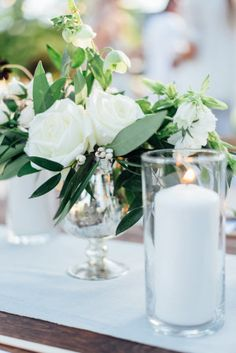 All white centerpiece for a rustic occasion: http://www.stylemepretty.com/living/2016/08/09/this-is-the-wildly-gorgeous-solution-to-a-gender-neutral-baby-shower/ Photography: Mariko Kay - http://marikokayphotography.com/