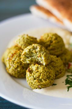 Oven-Baked Falafel close-up with a bite taken out | Plant-based | Oil-free | Vegan | Gluten-free | https://passtheplants.com/
