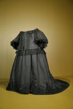 """1897 Dress worn by Queen Victoria. By this time she had a 50"""" waist (compared to 22"""" in her youth)."""