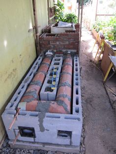 We used an existing wood stove and plugged it into a much larger brick heat exchange mass in order to heat a greenhouse and extend the gardening season.