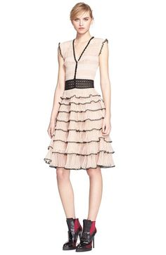 Free shipping and returns on Alexander McQueen Tiered V-Neck Dress at Nordstrom.com. Like the sweet bloom of a rose, frothy tiers of plissé ruffles bring showstopping romance to a dress detailed with glistening black lace and embroidery, as well as rouleau buttons tracing the V-neckline.