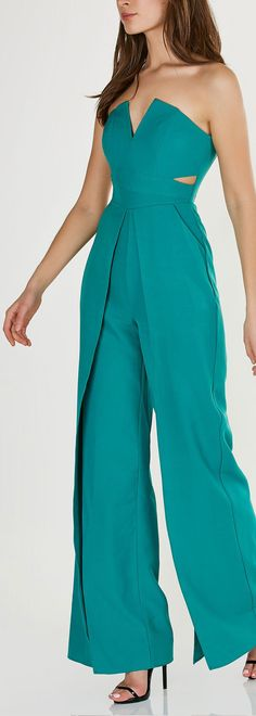 Stylish strapless jumpsuit with wired bust and trendy cut outs. Envelope style design with open slits on each leg for added detail. - Polyetser-Spandex blend - Imported - Model is wearing size S - Run