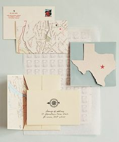 Map themed invites; heart over city instead of star.