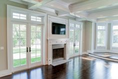 Michelle Winick Design: Incredible living room with coffered ceiling and hardwoo. Michelle Winick Design: Incredible living room with coffered ceiling and hardwood floors. The sunke Shiplap Fireplace, Farmhouse Fireplace, Fireplace Design, Fireplace Ideas, Custom Fireplace, Fireplace Mantle, Craftsman Fireplace, Fireplace Seating, Simple Fireplace