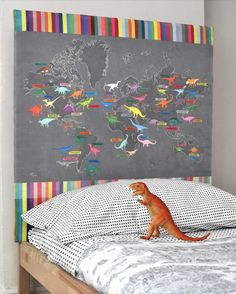 Dinosaur map headboard, great idea for little Dino lovers. #estella #kids #decor