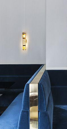 Blue velvet and brass detail