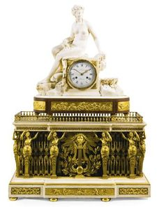 A LOUIS XVI-STYLE SCUPTURAL WHITE MARBLE MANTEL CLOCK ON AN ASSOCIATED LOUIS XVI ORGAN BASE, FRENCH, CIRCA 1785 AND LATER