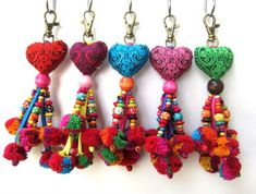 Heart Keychain Fabric Heart Pom Pom beaded Keychain Pom Pom Purse Charm Heart Purse Swag Assorted Colors Wholesale Accessories Heart and Pom Pom Keychain with Pretty Wood Beadwork and Cotton Pom Poms. The Hearts are slightly padded and sewn by han Craft Stick Crafts, Felt Crafts, Fabric Crafts, Handmade Keychains, Handmade Gifts, Pom Pom Purse, Crochet Patterns For Beginners, Schmuck Design, Fabric Jewelry