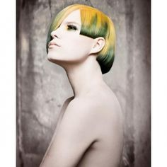 Avant-garde hairstyle with fringe and green and yellow colouring