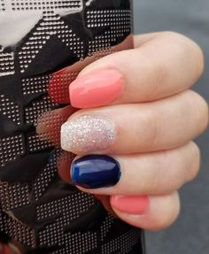 Navy, coral and sliver sparkle nails.