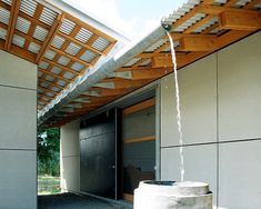 Gutter Design. Water run off and recycled water barrel. Eggleston Frakas Architects.