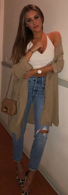 #winter #outfits white halter top and distressed blue jeans. Pic by @angelina.lilienne.