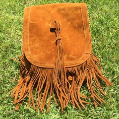 Tan Suede Fringe Backpack Suede fringe backpack (unsure if it's real suede) • brand new never used • big enough to fit books but small enough for everyday use • drawstring and magnetic snap closure • two interior phone pockets + one interior zipper pocket • unbranded Brandy Melville Bags Backpacks